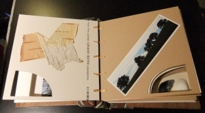 Book Pippa made for her mother 'about' her village. Showing inserts and collage.