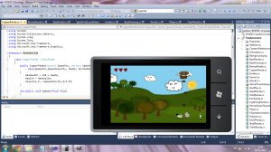 Screengrab showing coding and the finished phone game.