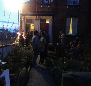 Gathering in the garden of the Flux Gallery at the break