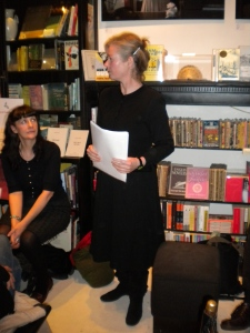 Róisín Tierney reading at a Rack Press launch watched by another Rack poet, Martina Evans