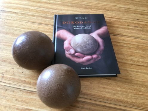 Evidence that Dorodango. The Japanese Art of Making Mud Balls is not only beautiful but an excellent manual. Two Dorodango I made from a clay/sand local soil.